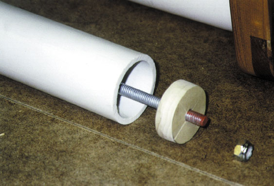 Stretcher assembly (PVC pipe, centering plug, threaded rod)