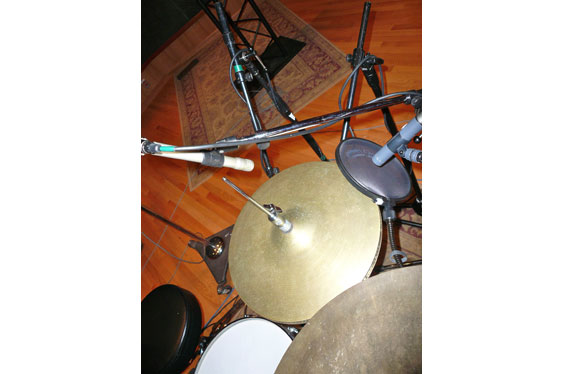 Two hi-hat mics (Neumann KM184 on the side and Shure SM81 over the top).