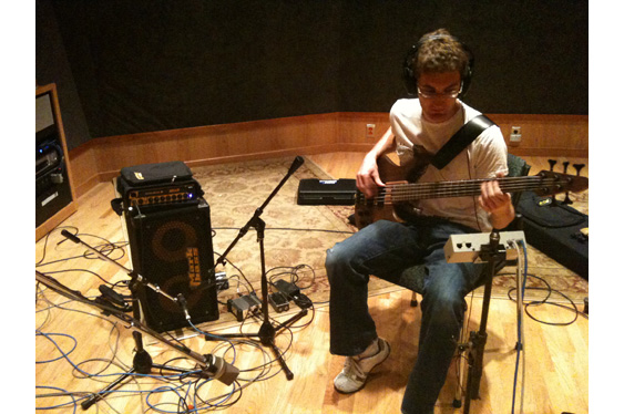 Connor Smith recording electric bass using various DIs as well as with a Shure SM57.