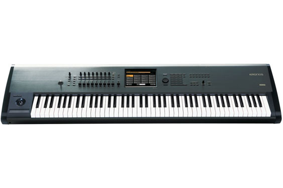 The Korg Kronos 88 keyboard workstation. Like the Yamaha, it also has a slider bank as well as the small ribbon strip. The Kronos also includes a joystick controller.