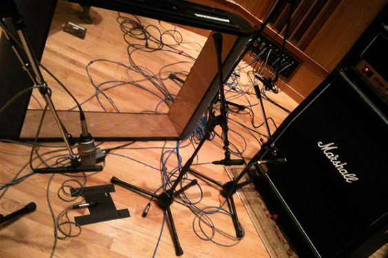 Guitar cabinet with mics setup to record interference demos. Note the plexiglass windowed gobo used to reflect sound from the amp to the TLM103 and AT4041 on the lefthand side of the picture. These were used to make TCRM9_1.wav through TCRM9_4.wav. The SM57s directly in front of the cabinet were used to make TCRM9_5.wav though TCRM9_8.wav (with the gobo removed).