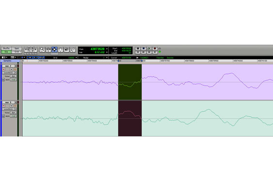 The difference between the two tracks in time can be measured in the DAW by highlighting the area and looking at the length displayed to the left of the transport (in ProTools). The left edge of the selection in the lower waveform is the same point as the right edge in the upper.